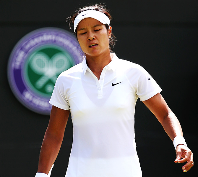 Li Na of China stands dejected after losing her third round match to Barbora Zahlavova Strycova of Czech Republic