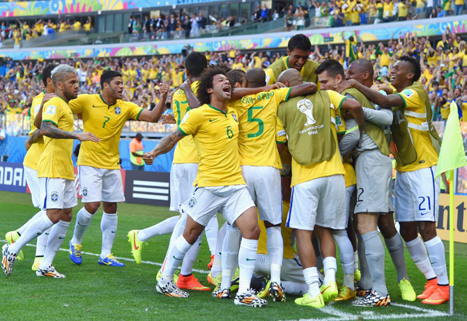 David Luiz of Brazil celebrates scoring his team's first goal with teammates