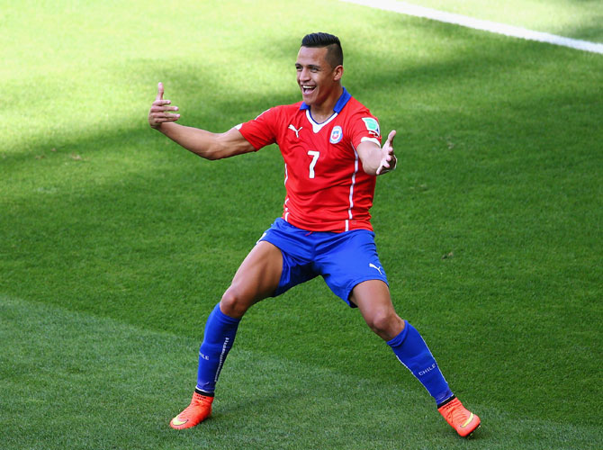 Alexis Sanchez of Chile celebrates scoring his team's first goal