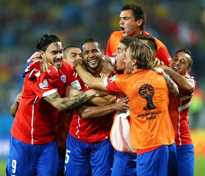 Chile's players celebrate after winning their match against Australia.