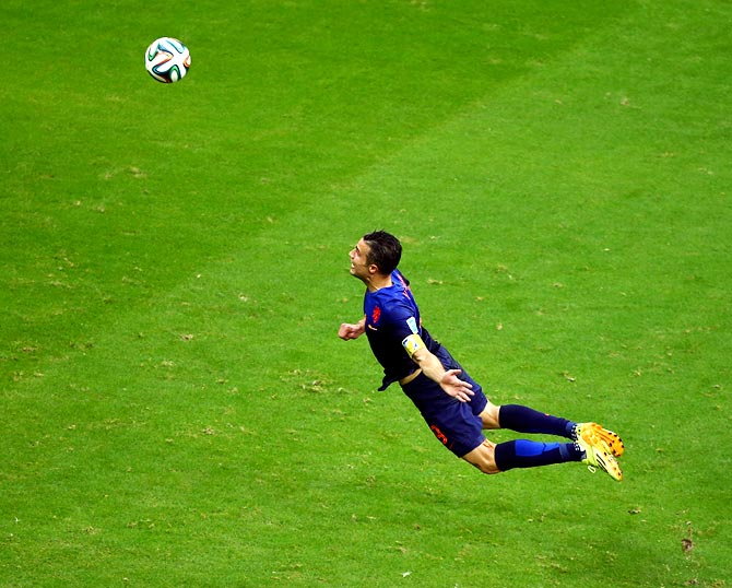 Robin van Persie of the Netherlands scores the first goal with a diving header against Spain