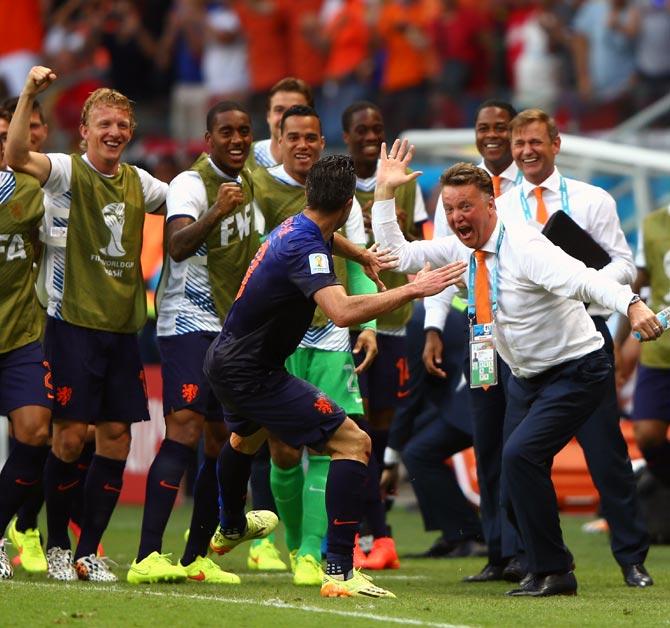 Robin van Persie of the Netherlands (centre) celebrates with head coach Louis van Gaal