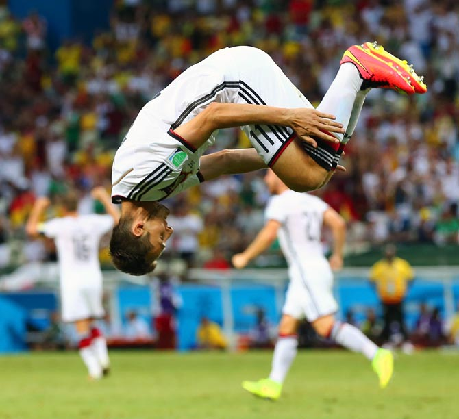 Miroslav Klose of Germany does a flip in celebration of scoring his team's second goal against Ghana
