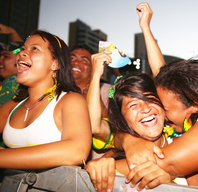 Fans cheer after Brazil scored a goal