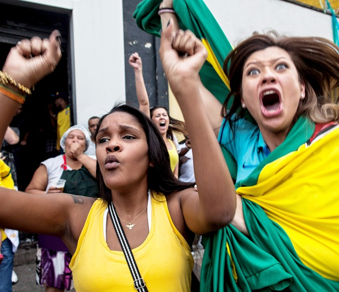 Fans watch the Round of 16 match between Brazil and Chile