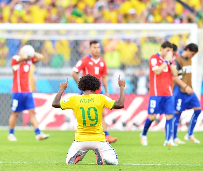 Willian of Brazil celebrates after defeating Chile in a penalty shootout