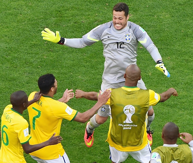 Julio Cesar of Brazil celebrates with teammates after defeating Chile in a penalty shootout