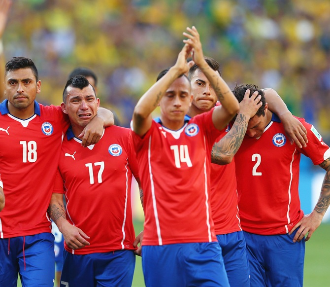 From left, Gonzalo Jara, Gary Medell, Fabian Orellana, Eduardo Vargas and Eugenio Mena of Chile react after being defeated by Brazil
