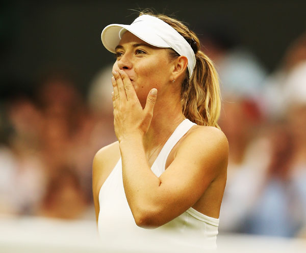 Maria Sharapova of Russia celebrates after winning her third round match against Alison Riske of the United States