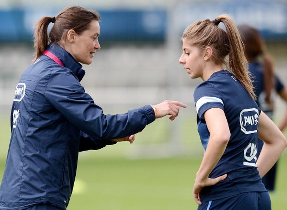 French women's national football team coach Corinne Diacre, left