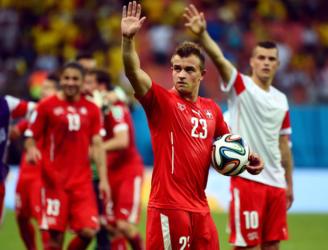 Xherdan Shaqiri of Switzerland acknowledges the fans