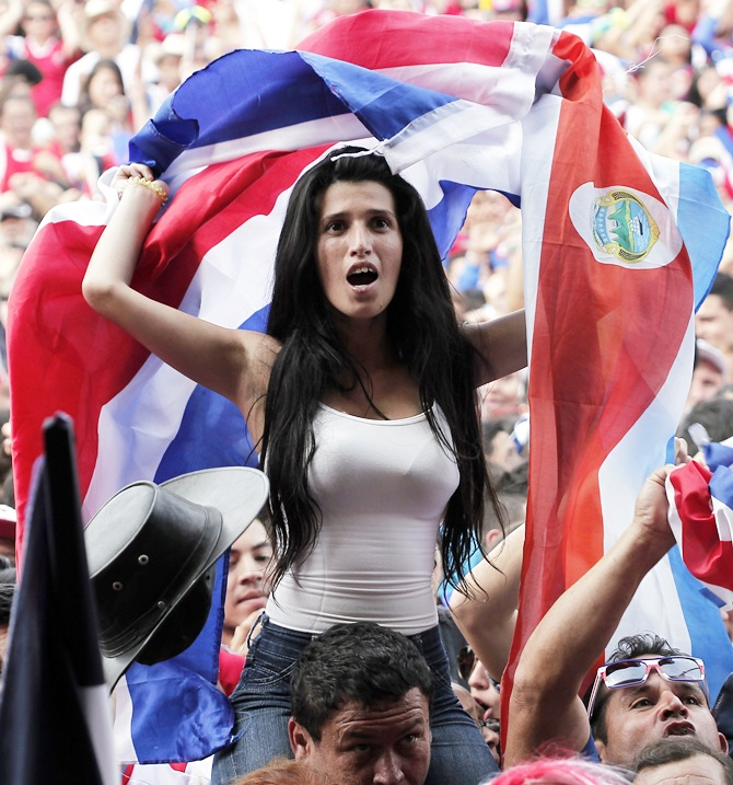 Costa Rica's fans celebrate after their team scored a goal against Greece as they watch a broadcast of their 2014 World Cup round of 16 game in San Jose