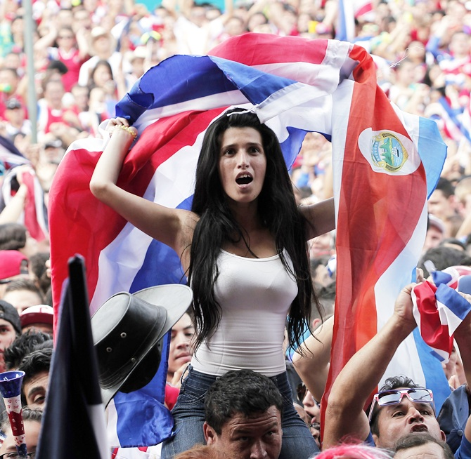 Costa Rica's fans celebrate after their team scored a goal against Greece