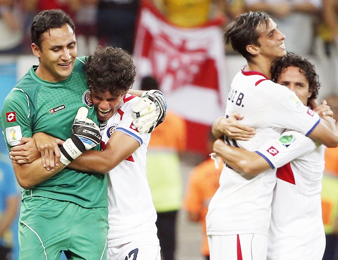 Costa Rica midfielder Yeltsin Tejeda (17) hugs Costa Rica goalkeeper Keylor Navas (1) after they defeated Greece