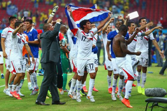 Yeltsin Tejeda of Costa Rica celebrates with teammates defeating Greece in a penalty shootout