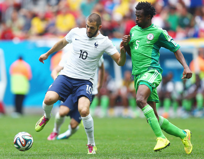 Karim Benzema of France controls the ball against Efe Ambrose of Nigeria