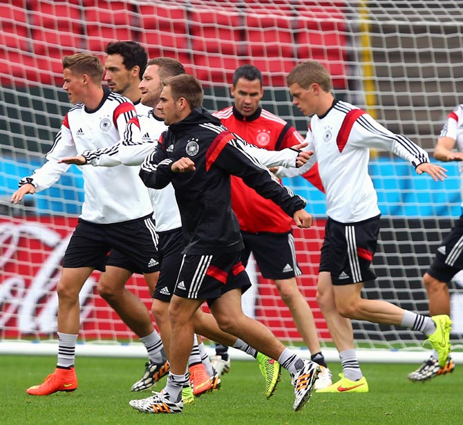 Germany's players warm up during a training session