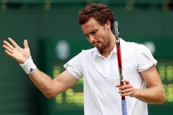 Ernests Gulbis reacts during his first round match against Jurgen Zopp of Estonia