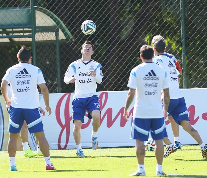 Lionel Messi of Argentina warms up during a training session at Cidade do Galo