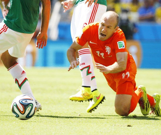 Arjen Robben of the Netherlands reacts after being fouled