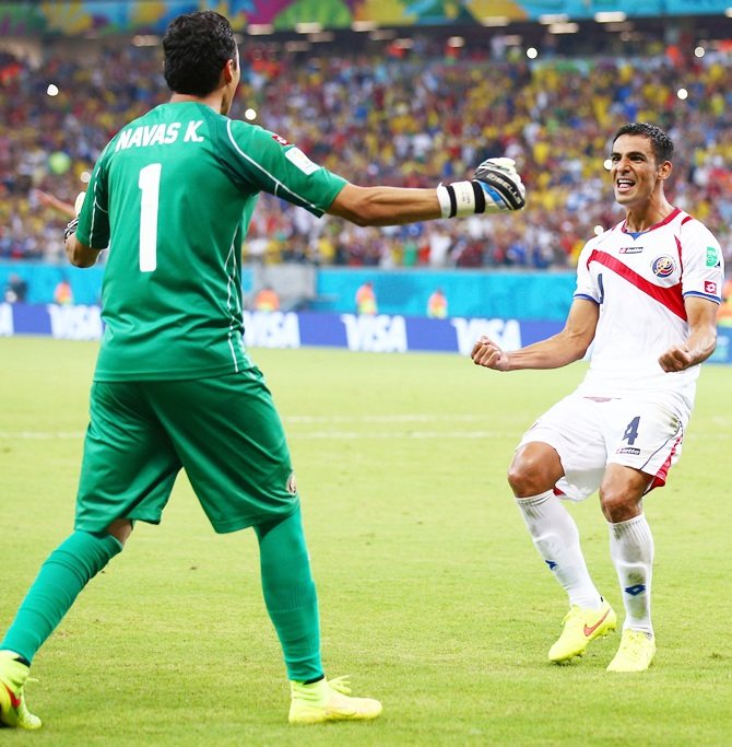 Keylor Navas, left, and Michael Umana of Costa Rica celebrate after defeating Greece in a penalty shootout