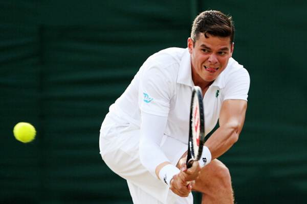 Milos Raonic of Canada plays a backhand return during his third round match against Lukasz Kubot of Poland