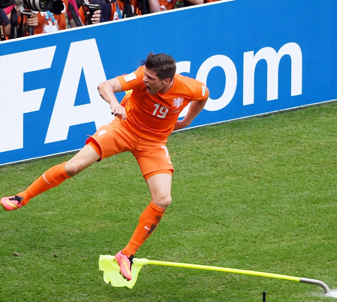 Klaas-Jan Huntelaar of the Netherlands celebrates scoring his team's second goal on a penalty kick in stoppage time