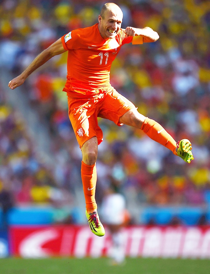 Arjen Robben of the Netherlands celebrates after defeating Mexico 2-1