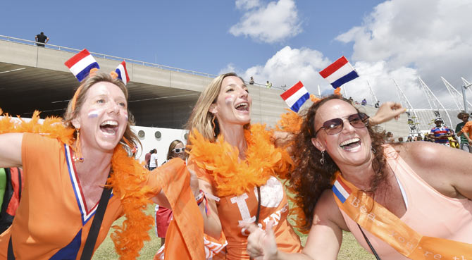 Fans arrive at Arena Castelao stadium for the Netherlands v Mexico match on Sunday