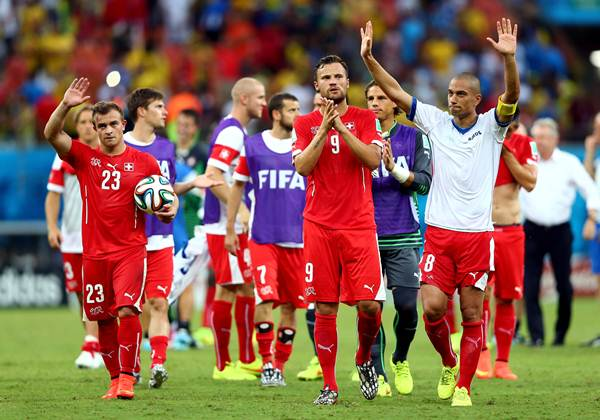 Xherdan Shaqiri, Haris Seferovic and Gokhan Inler of Switzerland acknowledge the fans after a 3-0 victory over Honduras