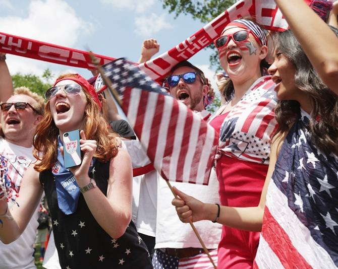 Fans cheer after hearing the news that Team USA will advance to the next round of the World Cup