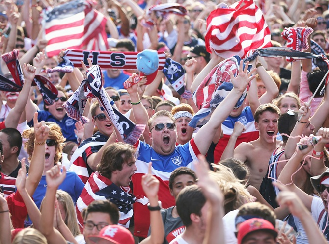 Fans in Grant Park celebrate a goal by the US against Portugal in a Group G   World Cup soccer match on June 22, 2014 in Chicago, Illinois. Fans were turned   away from the free event after a 10,000-person capacity was reached.