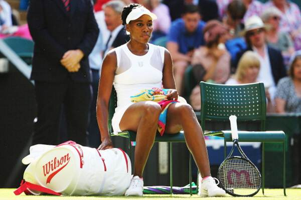 Venus Williams of the United States takes a break during a change of ends in her third round match against Petra Kvitova of Czech Republic