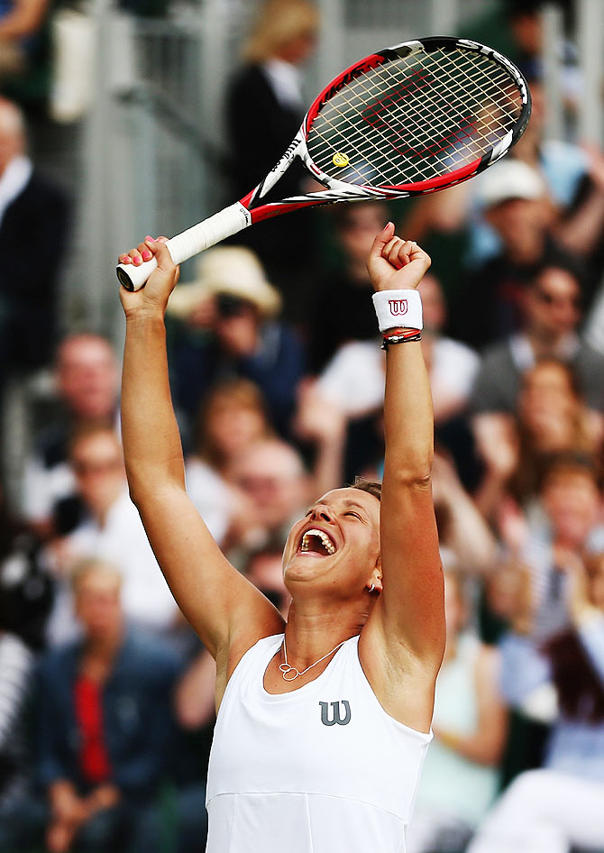 Barbora Zahlavova Strycova of Czech Republic celebrates after winning her fourth round match against Caroline Wozniacki of Denmark at the All England Lawn Tennis and Croquet Club on Monday