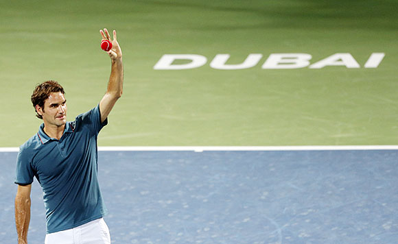 Roger Federer of Switzerland celebrates after defeating Novak Djokovic of Serbia in their men's singles semi-final match at the ATP Dubai Tennis Championships on Friday