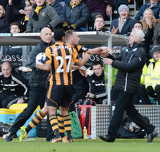David Meyler of Hull City pushes Alan Pardew, manager of Newcastle United during the Barclays Premier League match