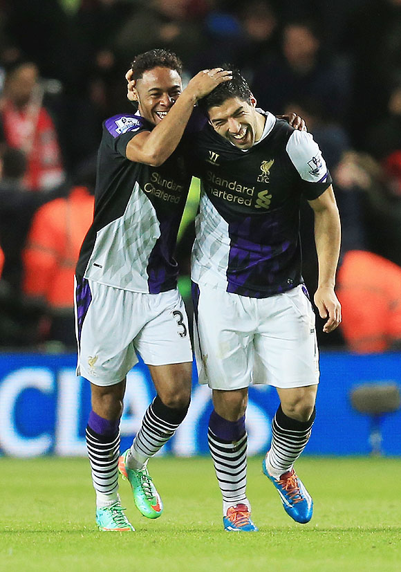 Liverpool's Raheem Sterling (left) celebrates his goal with Luis Suarez on Saturday