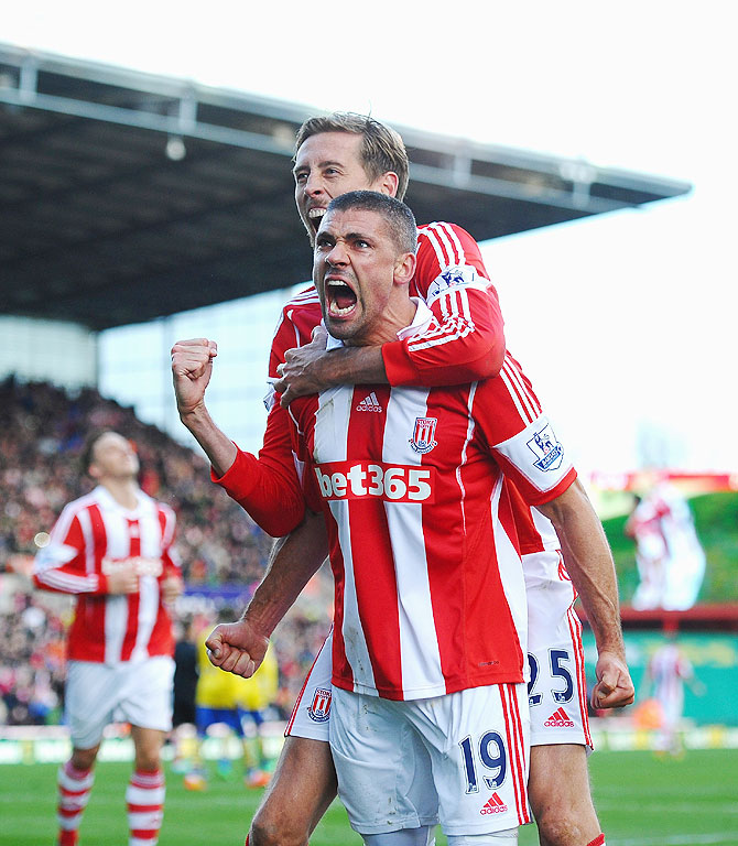 Jonathan Walters of Stoke City celebrates his goal with Peter Crouch during their Premier League match against Arsenal on Saturday