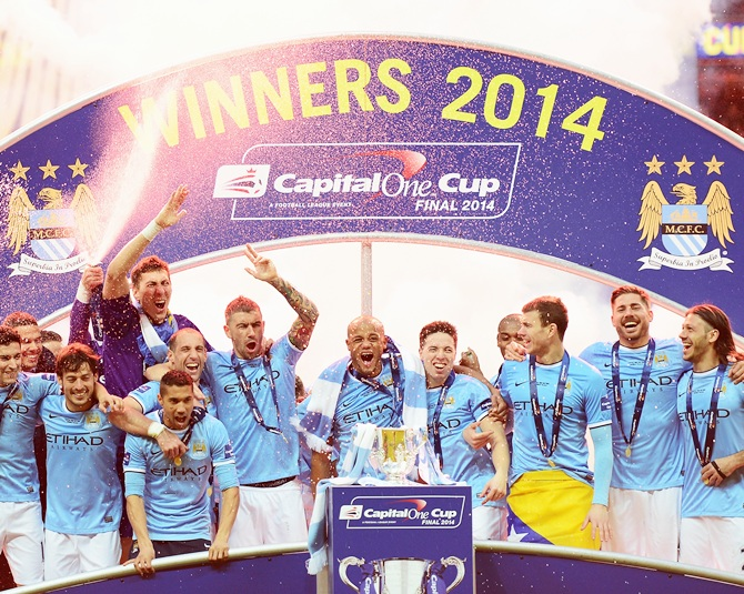 Manchester City players celebrate victory.