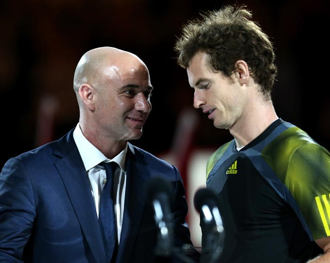 Andre Agassi (left) speaks to Andy Murray