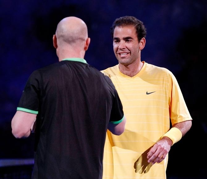 Pete Sampras (right) with Andre Agassi