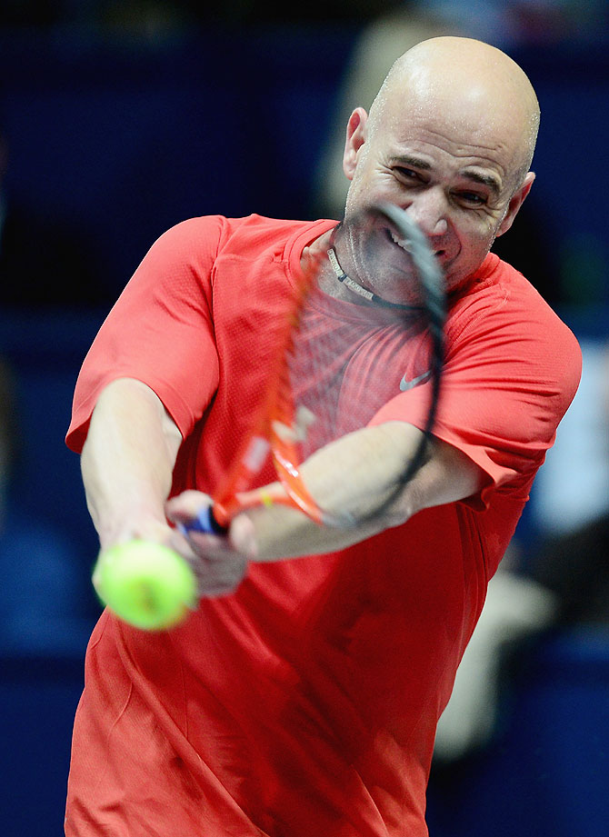Andre Agassi in action against Pete Sampras in the exhibition match during the World Tennis Day London Showdown at the Athenaeum Hotel at Piccadilly on Monday