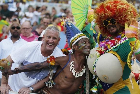Brazilian fans dance.