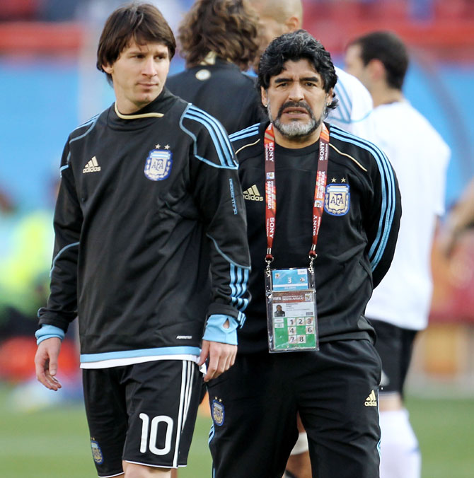Diego Maradona head coach of Argentina conducts warm up exercises with striker Lionel Messi