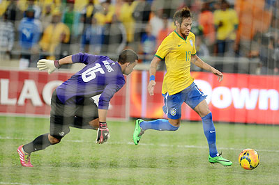 Brazil's Neymar attempts to score past South Africa's Ronwen Williams during their international friendly at FNB Stadium in Johannesburg on Wednesday
