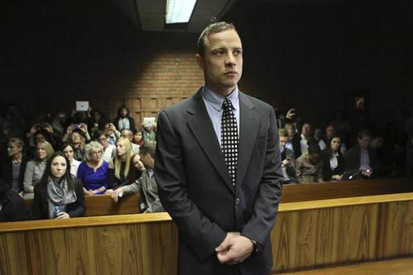 Oscar Pistorius enters the dock before court proceedings at the Pretoria Magistrates court June 4, 2013