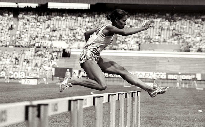 P T Usha clears a hurdle on her way to the gold medal and first place in the women's 400 metres hurdles at the Asian Games in Seoul, September 30, 1986