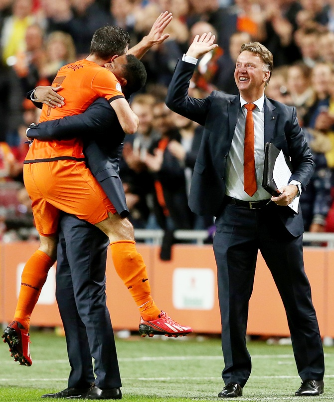 Robin van Persie of Holland celebrates with Patrick Kluivert and manager Luis van Gaal.