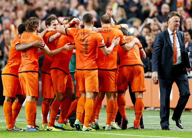 Holland manager Louis van Gaal celebrates with his team.