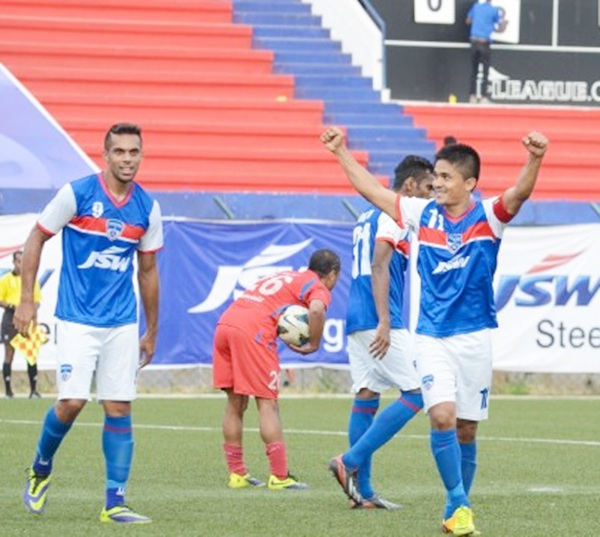 Sunil Chhetri, right, celebrates his second goal of the match.